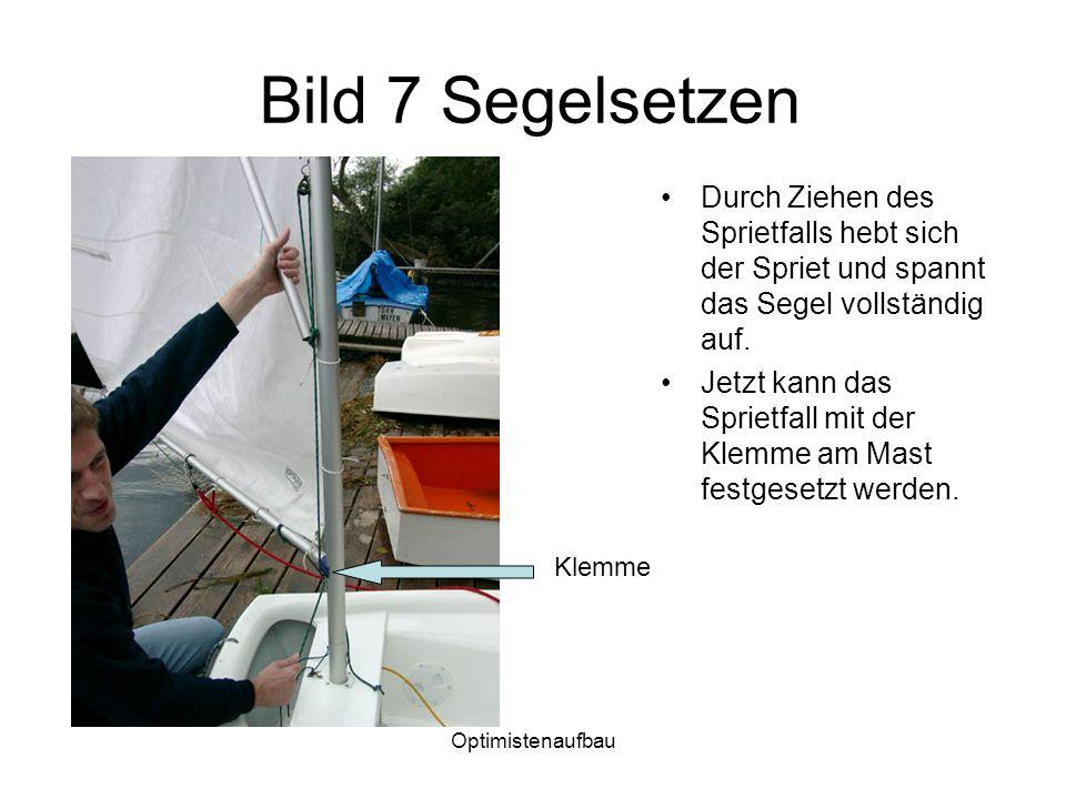 Optimistenaufbau Bild 7 Segelsetzen Durch Ziehen des Sprietfalls hebt sich der Spriet und spannt das Segel vollständig auf. Jetzt kann das Sprietfall