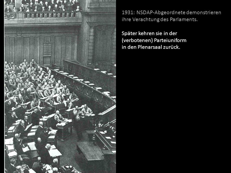 1931: NSDAP-Abgeordnete demonstrieren ihre Verachtung des Parlaments. Später kehren sie in der (verbotenen) Parteiuniform in den Plenarsaal zurück.