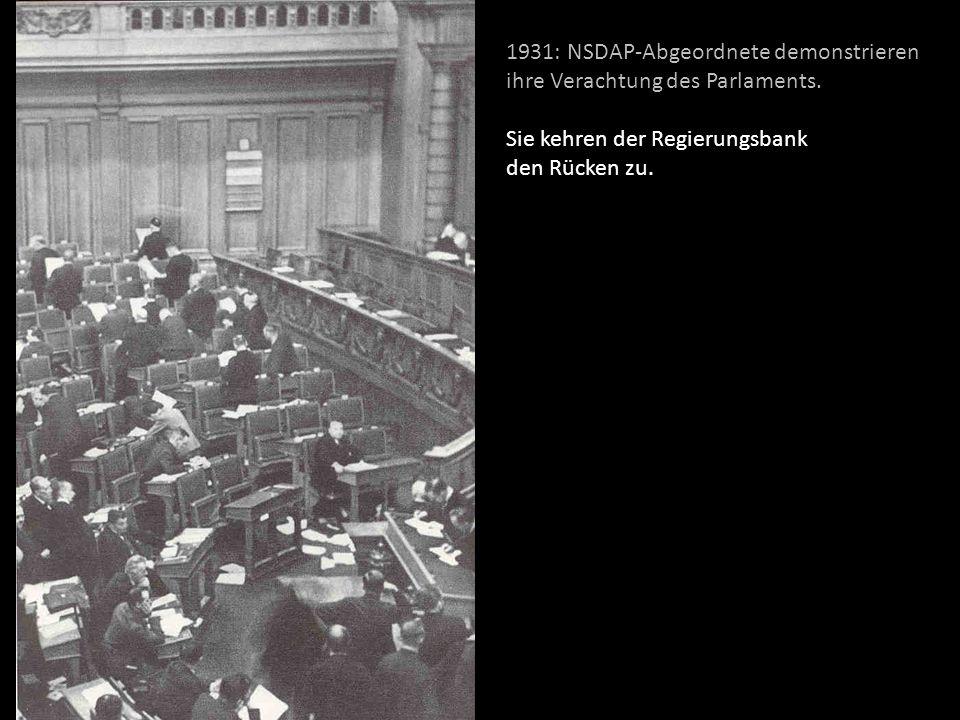 1931: NSDAP-Abgeordnete demonstrieren ihre Verachtung des Parlaments. Sie kehren der Regierungsbank den Rücken zu.