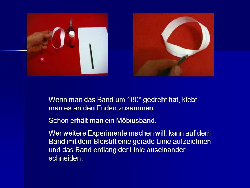 Wenn man das Band um 180° gedreht hat, klebt man es an den Enden zusammen. Schon erhält man ein Möbiusband. Wer weitere Experimente machen will, kann