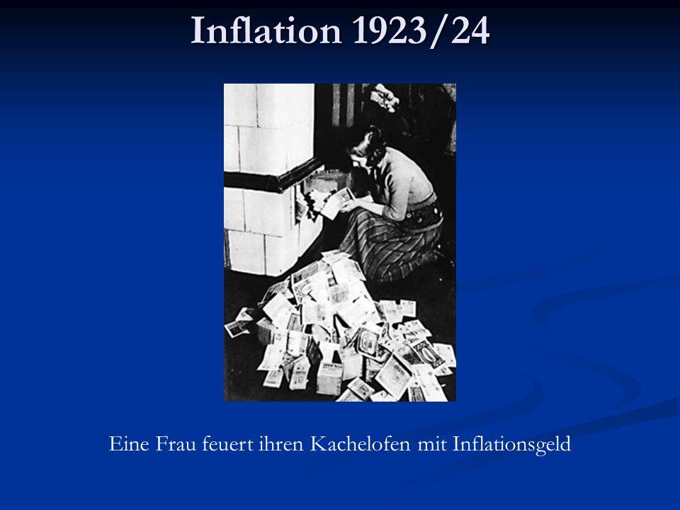 Inflation 1923/24 Eine Frau feuert ihren Kachelofen mit Inflationsgeld
