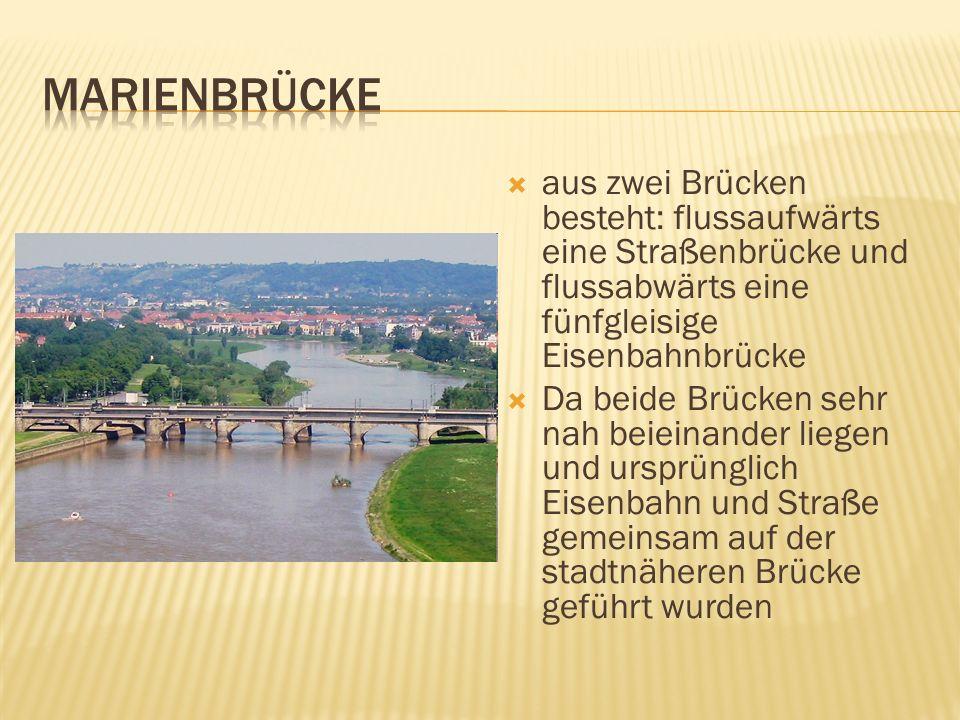 aus zwei Brücken besteht: flussaufwärts eine Straßenbrücke und flussabwärts eine fünfgleisige Eisenbahnbrücke Da beide Brücken sehr nah beieinander li
