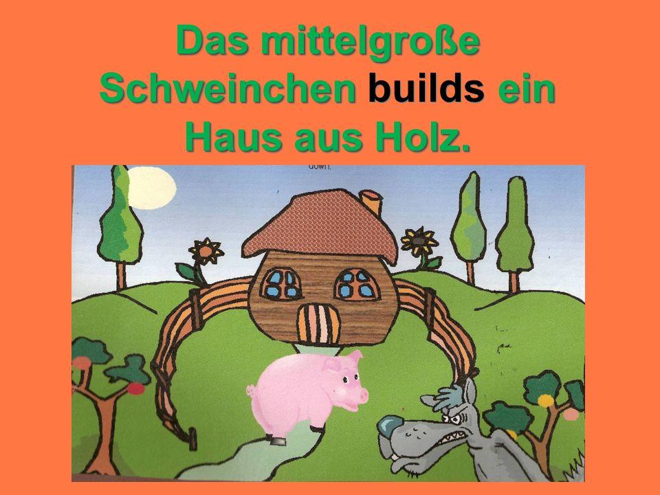 Das mittelgroße Schweinchenein Haus aus Holz. Das mittelgroße Schweinchen builds ein Haus aus Holz.