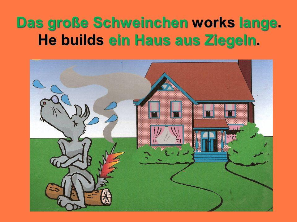 Das große Schweinchen lange ein Haus aus Ziegeln Das große Schweinchen works lange. He builds ein Haus aus Ziegeln.