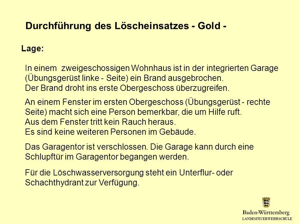 LANDESFEUERWEHRSCHULE Durchführung des Löscheinsatzes - Gold - In einem zweigeschossigen Wohnhaus ist in der integrierten Garage (Übungsgerüst linke -