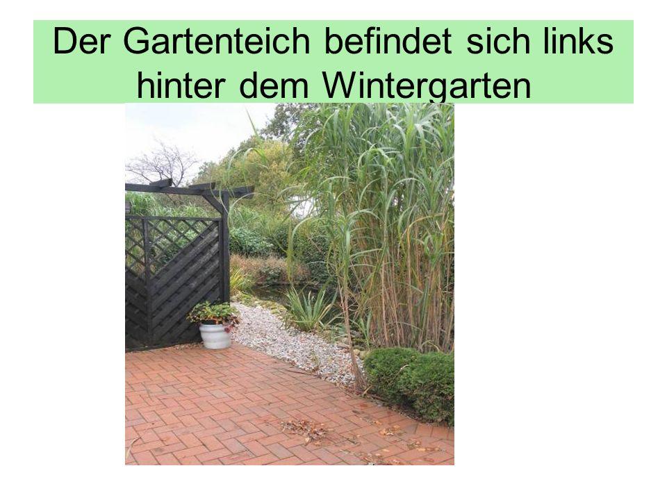 Der Gartenteich befindet sich links hinter dem Wintergarten