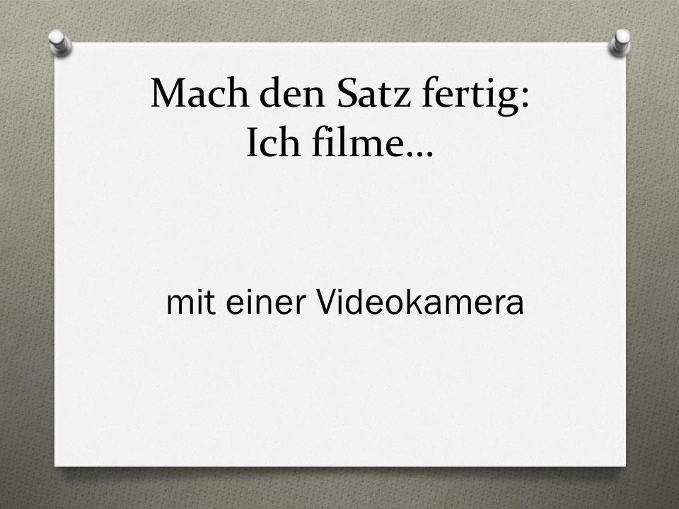 Mach den Satz fertig: Ich filme… mit einer Videokamera