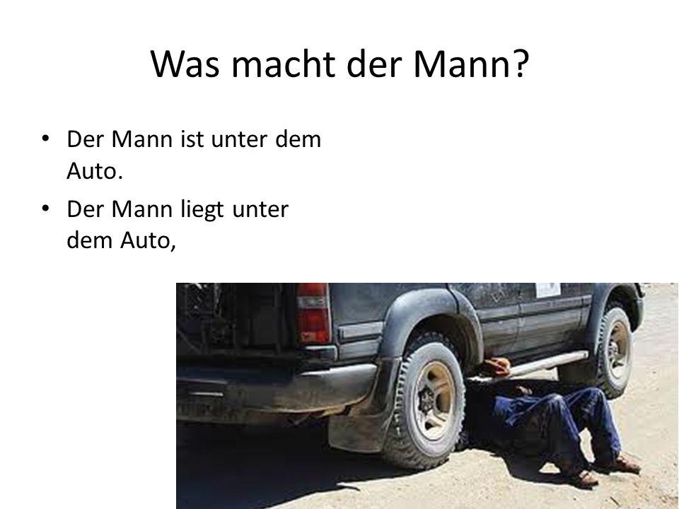 Was macht der Mann Der Mann ist unter dem Auto. Der Mann liegt unter dem Auto,
