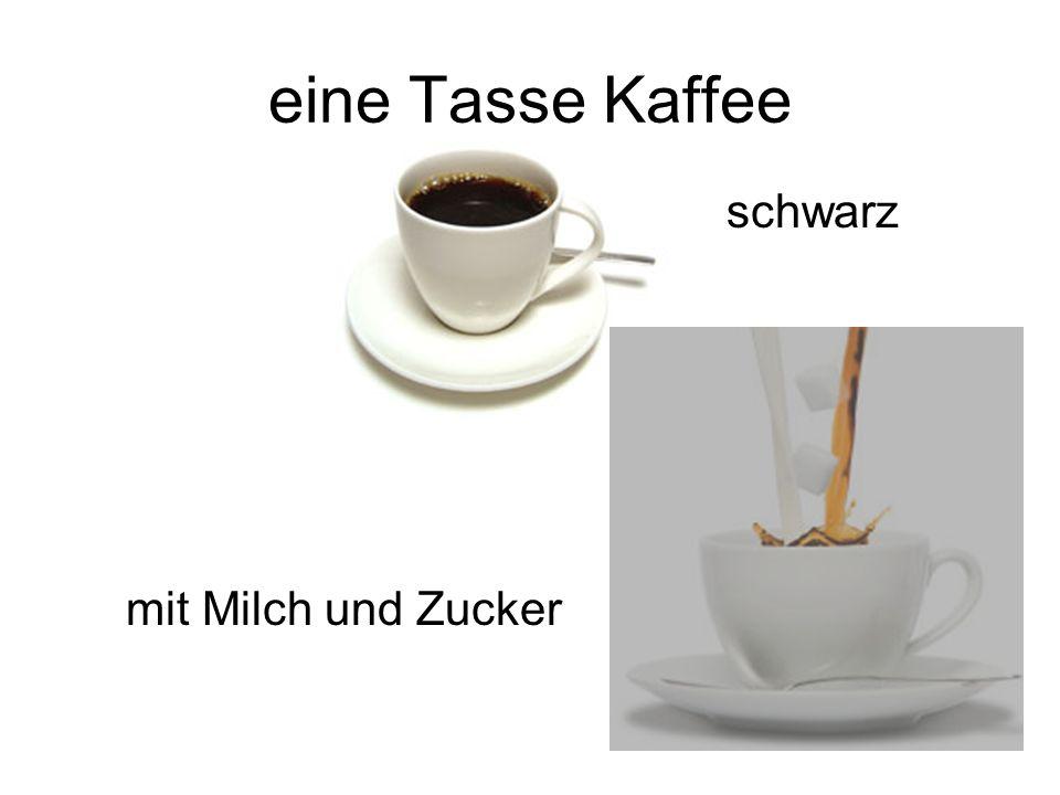 eine Tasse Kaffee schwarz mit Milch und Zucker
