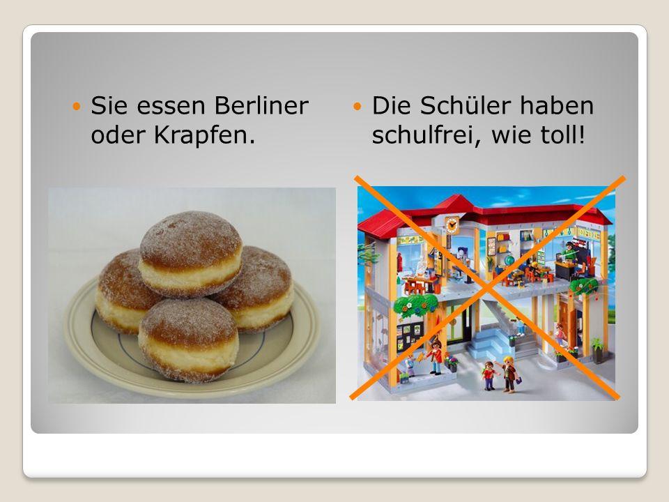 Sie essen Berliner oder Krapfen. Die Schüler haben schulfrei, wie toll!