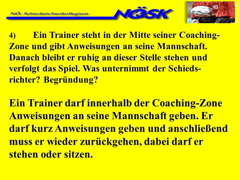 4) Ein Trainer steht in der Mitte seiner Coaching- Zone und gibt Anweisungen an seine Mannschaft.