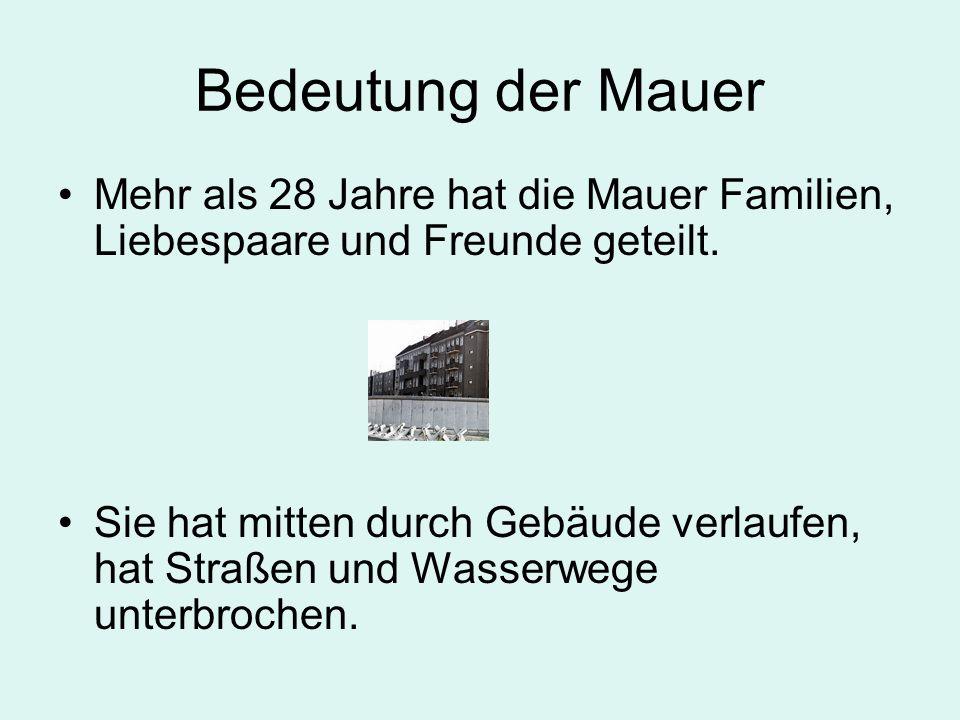 Bedeutung der Mauer Mehr als 28 Jahre hat die Mauer Familien, Liebespaare und Freunde geteilt. Sie hat mitten durch Gebäude verlaufen, hat Straßen und