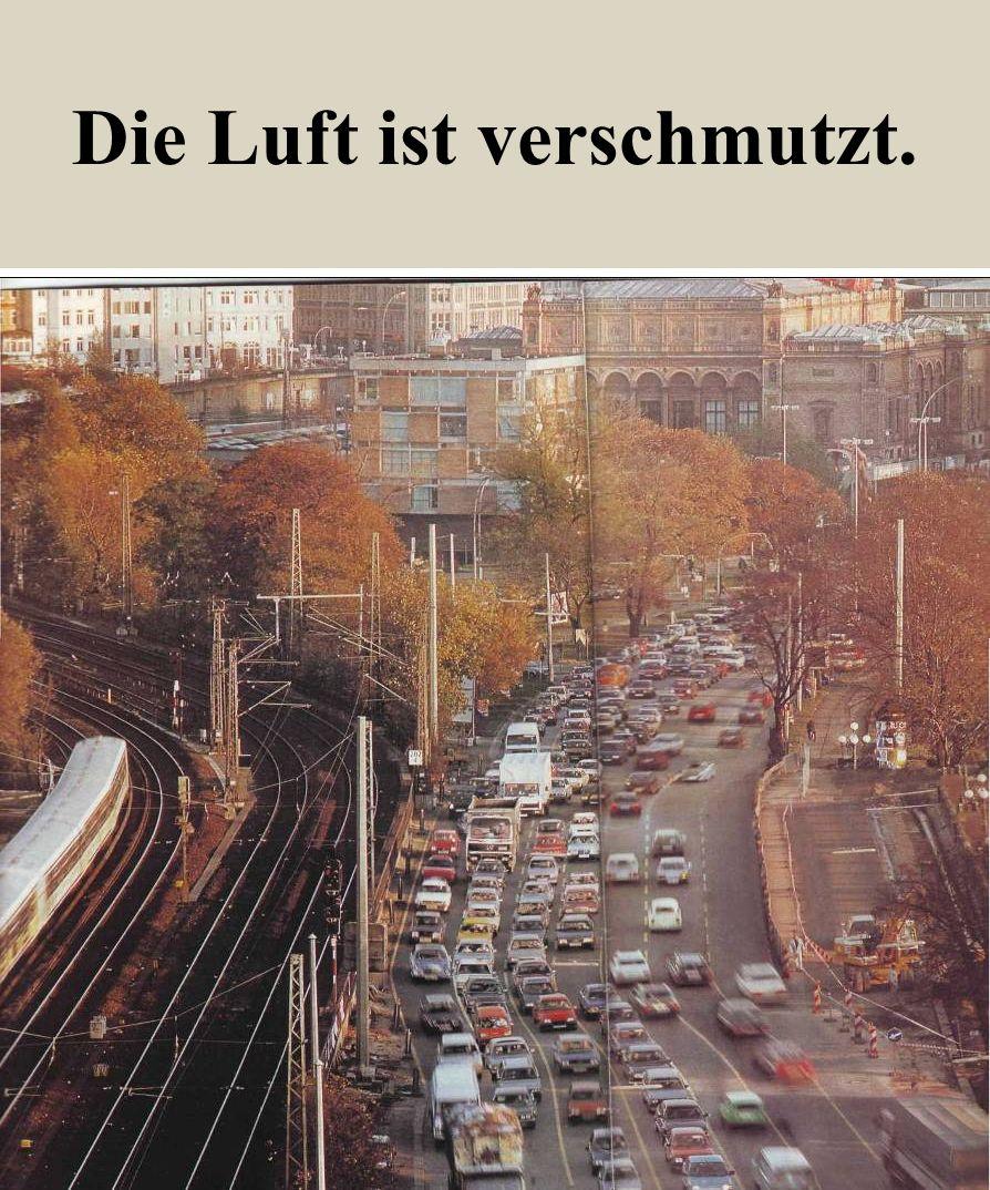 Asphalt, Beton, Autos verschmutzen die Luft der Städte.
