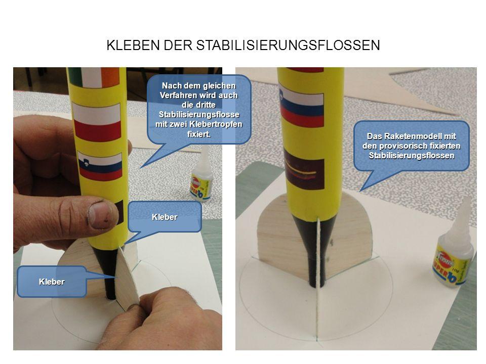 KLEBEN DER STABILISIERUNGSFLOSSEN Nach dem gleichen Verfahren wird auch die dritte Stabilisierungsflosse mit zwei Klebertropfen fixiert. Das Raketenmo