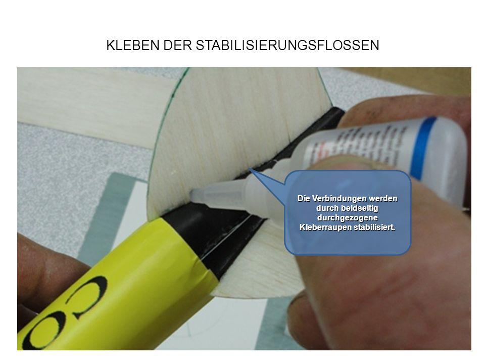KLEBEN DER STABILISIERUNGSFLOSSEN Die Verbindungen werden durch beidseitig durchgezogene Kleberraupen stabilisiert.