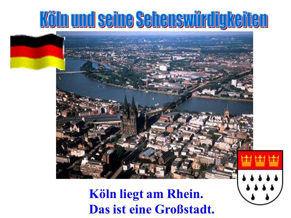 Köln liegt am Rhein. Das ist eine Großstadt.