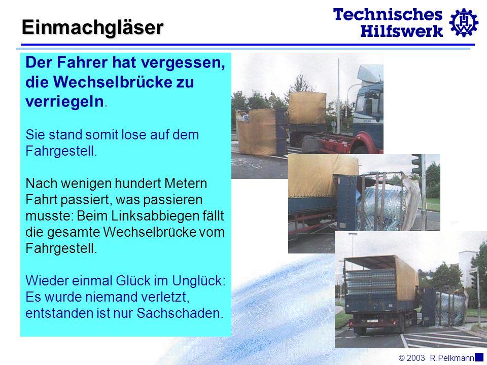 © 2003R.Pelkmann Einmachgläser Der Fahrer hat vergessen, die Wechselbrücke zu verriegeln.