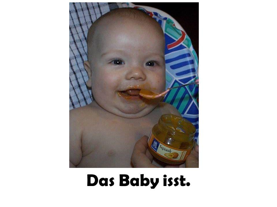 Das Baby isst.
