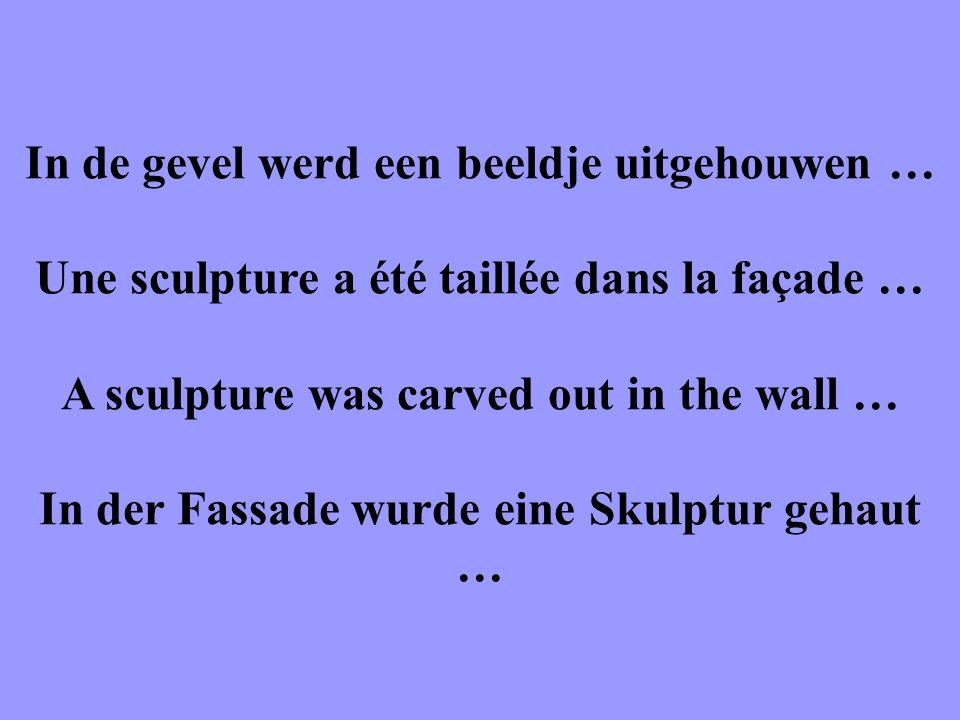 In de gevel werd een beeldje uitgehouwen … Une sculpture a été taillée dans la façade … A sculpture was carved out in the wall … In der Fassade wurde eine Skulptur gehaut …