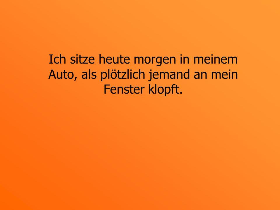 Ein kleiner Mann mit einer schwarz-rot- goldenen Deutschland-Kappe steht neben meinem Wagen.