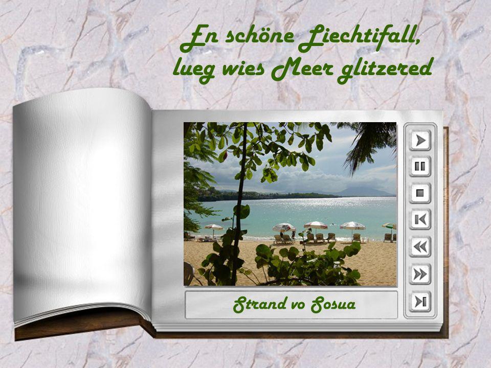 En schöne Liechtifall, lueg wies Meer glitzered Strand vo Sosua
