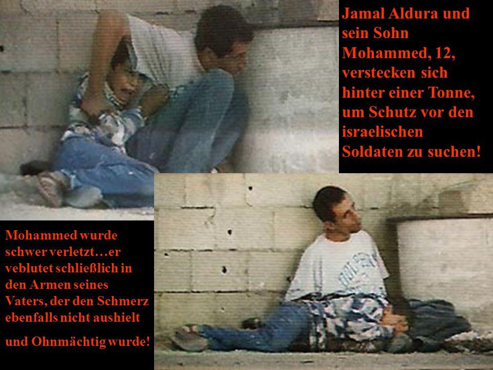 Jamal Aldura und sein Sohn Mohammed, 12, verstecken sich hinter einer Tonne, um Schutz vor den israelischen Soldaten zu suchen.