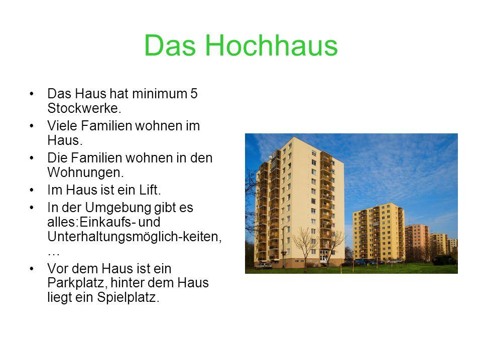 Das Hochhaus Das Haus hat minimum 5 Stockwerke. Viele Familien wohnen im Haus. Die Familien wohnen in den Wohnungen. Im Haus ist ein Lift. In der Umge