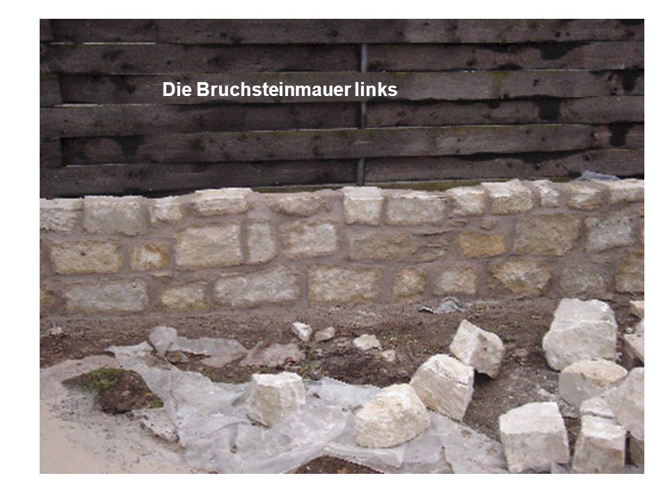 Die Bruchsteinmauer links