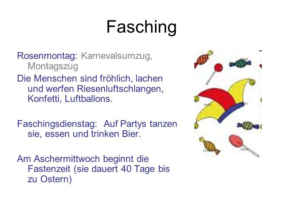 Fasching Rosenmontag: Karnevalsumzug, Montagszug Die Menschen sind fröhlich, lachen und werfen Riesenluftschlangen, Konfetti, Luftballons. Faschingsdi