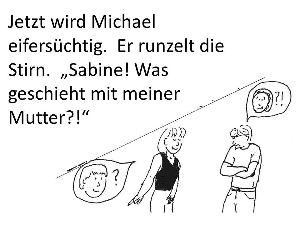 Sabine nimmt Michael zur Herrenabteilung mit.Sie sieht einen schicken, schwarzen Anzug.