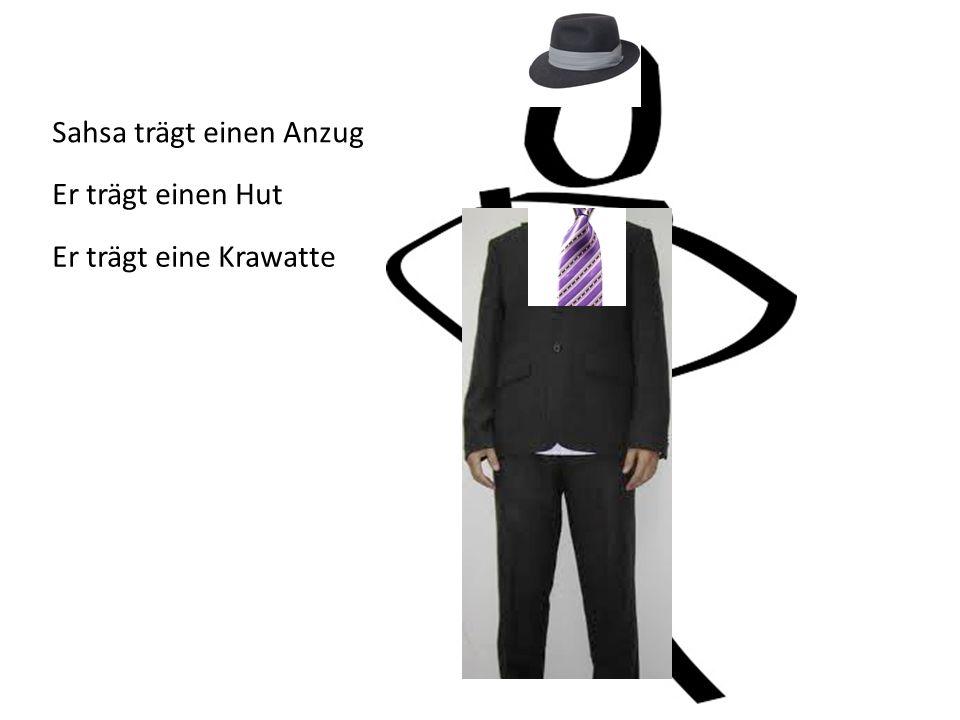 Sahsa trägt einen Anzug Er trägt einen Hut Er trägt eine Krawatte