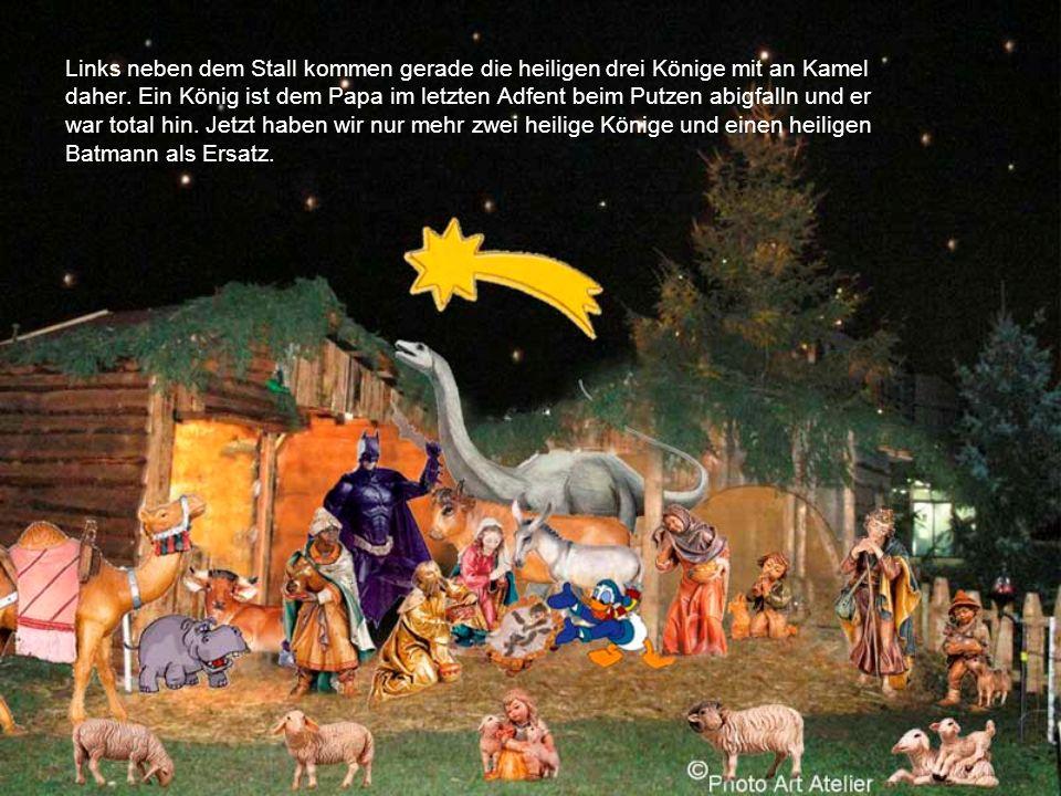 Links neben dem Stall kommen gerade die heiligen drei Könige mit an Kamel daher.