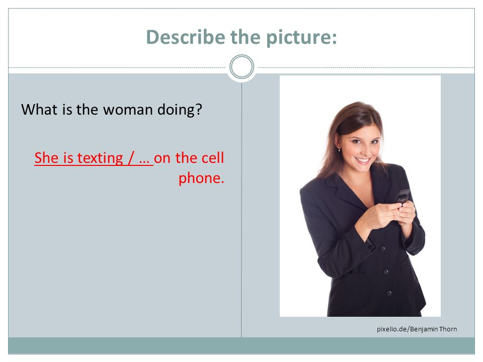 Describe the picture: What is the woman doing. She is texting / … on the cell phone.