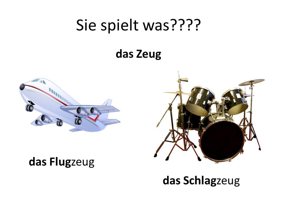 Sie spielt was???? das Zeug das Flugzeug das Schlagzeug