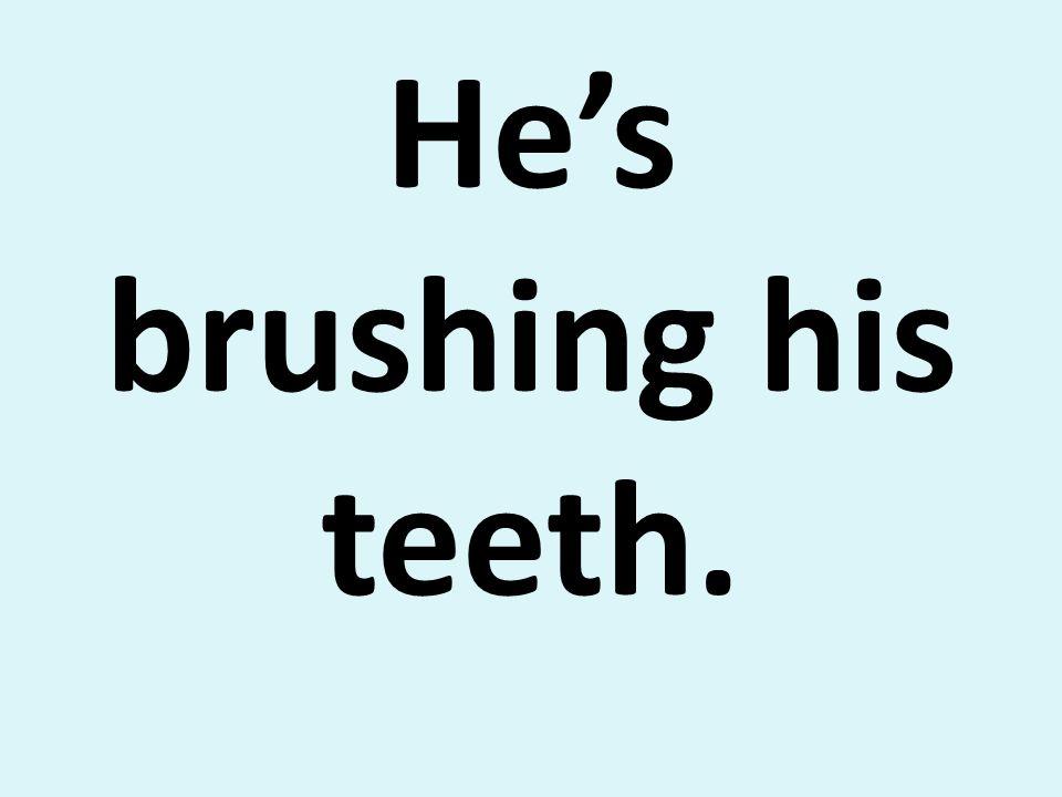 Hes brushing his teeth.