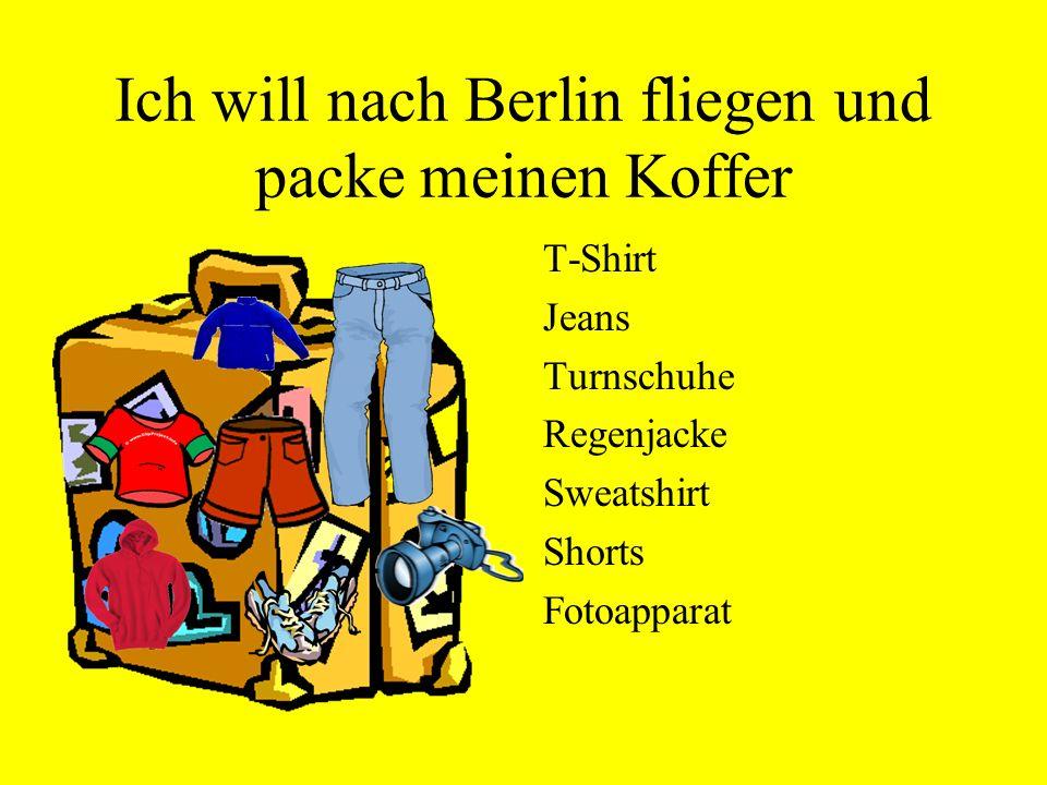 Ich will nach Berlin fliegen und packe meinen Koffer T-Shirt Jeans Turnschuhe Regenjacke Sweatshirt Shorts Fotoapparat