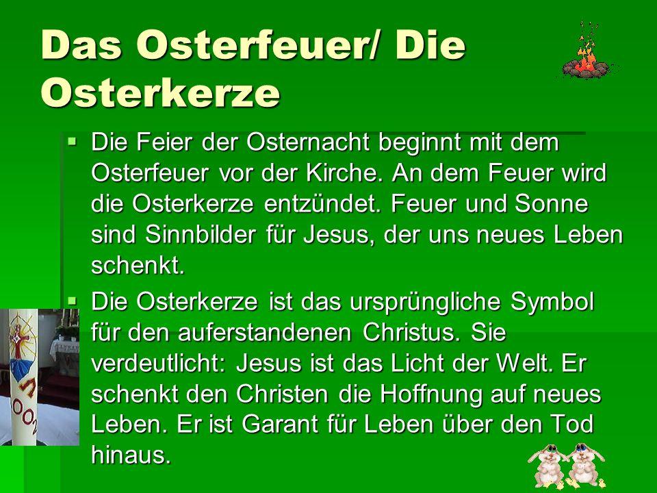 Das Osterfeuer/ Die Osterkerze Die Feier der Osternacht beginnt mit dem Osterfeuer vor der Kirche. An dem Feuer wird die Osterkerze entzündet. Feuer u