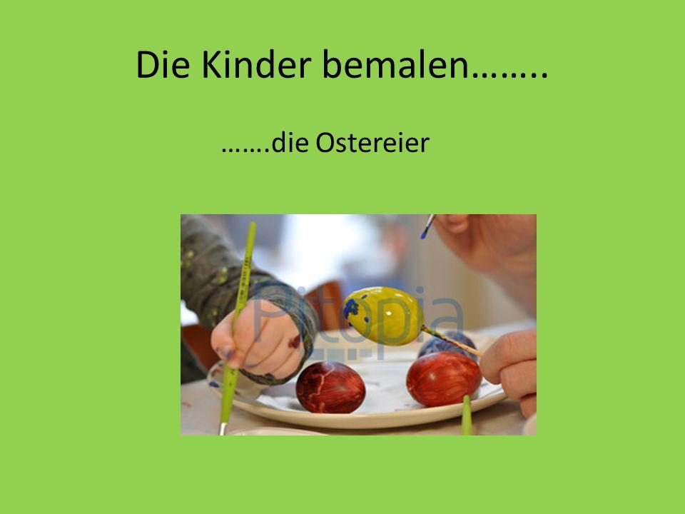 Die Kinder bemalen…….. …….die Ostereier
