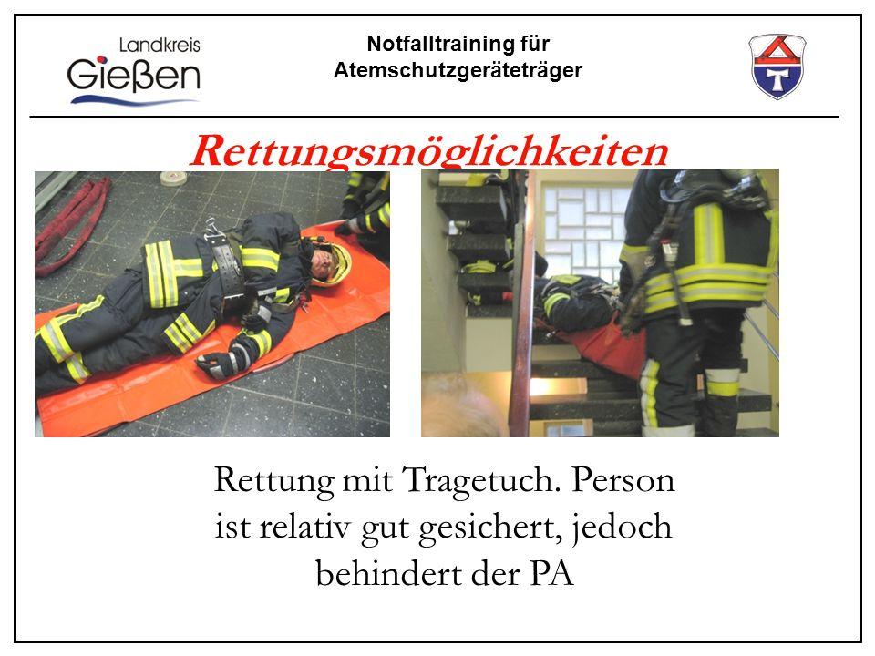 Notfalltraining für Atemschutzgeräteträger Rettungsmöglichkeiten Rettung mit Tragetuch. Person ist relativ gut gesichert, jedoch behindert der PA