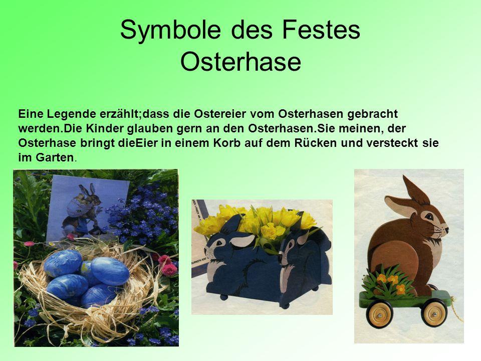 Symbole des Festes Osterhase Eine Legende erzählt;dass die Ostereier vom Osterhasen gebracht werden.Die Kinder glauben gern an den Osterhasen.Sie mein
