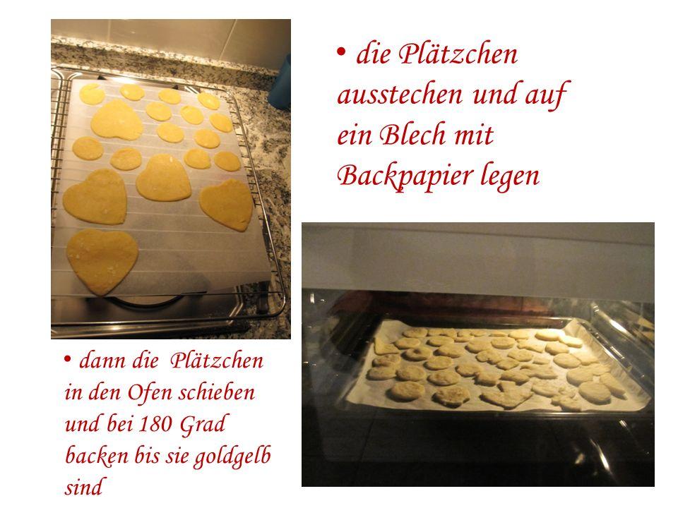die Plätzchen ausstechen und auf ein Blech mit Backpapier legen dann die Plätzchen in den Ofen schieben und bei 180 Grad backen bis sie goldgelb sind