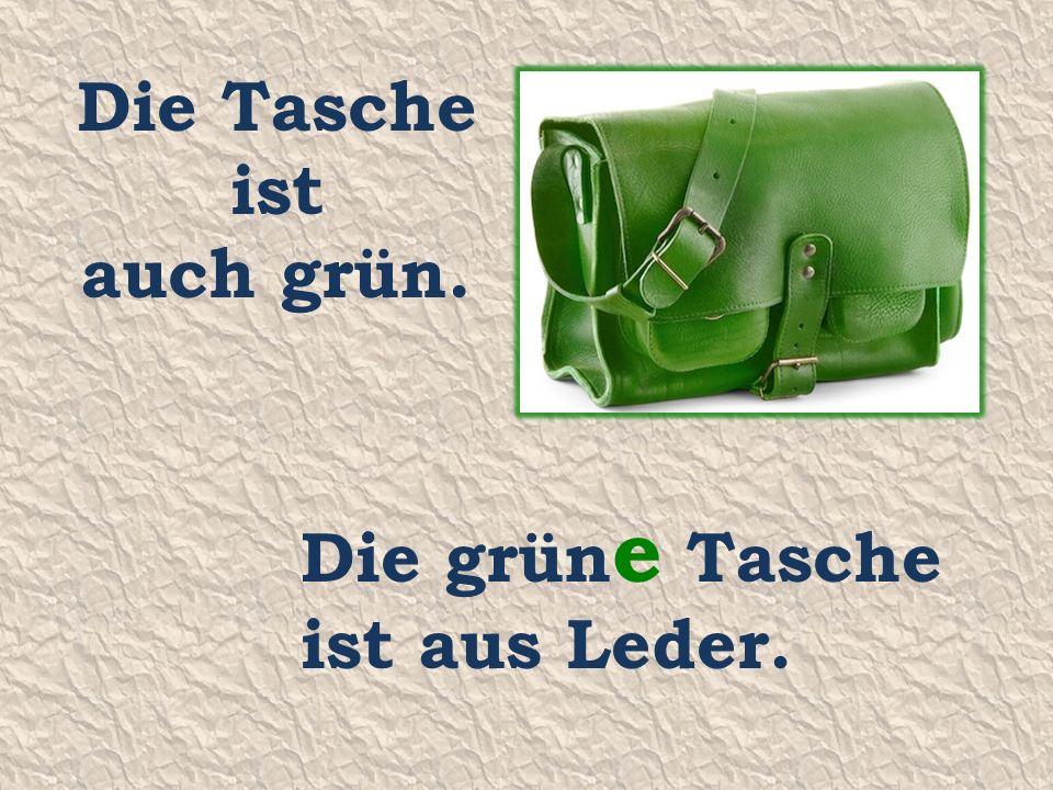 Die Tasche ist auch grün. Die grün e Tasche ist aus Leder.
