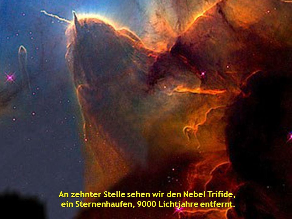An neunter Position zwei verwirbelte Galaxien, NGC 2207 und IC 2163, die 114 Millionen Lichtjahre entfernt sind.