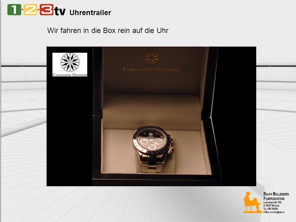 Uhrentrailer Die Meisterdiebin liegt (aufgestütz auf Ellenbogen) neben ihrer Lieblingsuhr