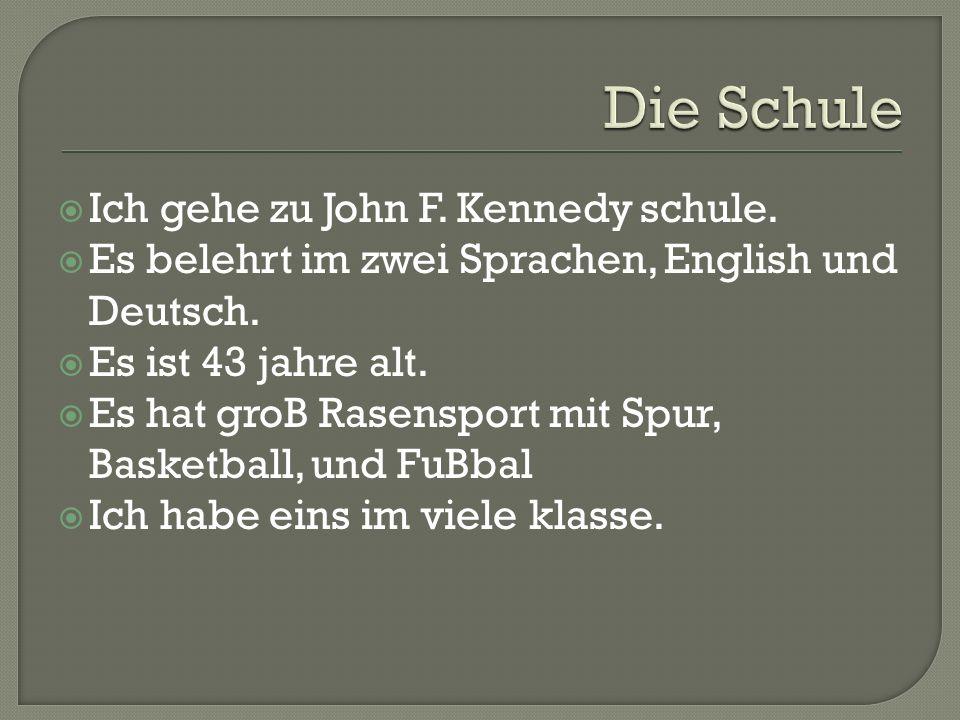 Ich gehe zu John F. Kennedy schule. Es belehrt im zwei Sprachen, English und Deutsch. Es ist 43 jahre alt. Es hat groB Rasensport mit Spur, Basketball
