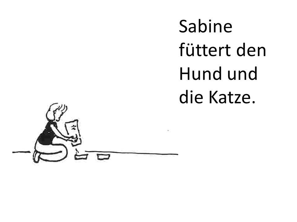 Sabine füttert den Hund und die Katze.