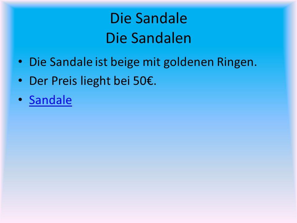 Die Sandale Die Sandalen Die Sandale ist beige mit goldenen Ringen.