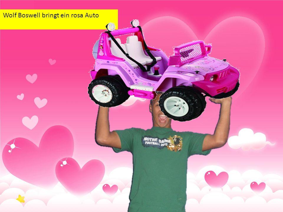 Wolf Boswell bringt ein rosa Auto