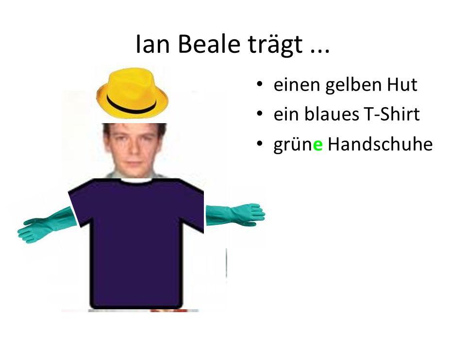 Ian Beale trägt... einen gelben Hut ein blaues T-Shirt grüne Handschuhe