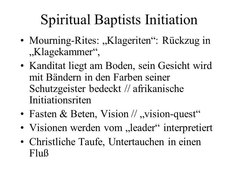 Spiritual Baptists Initiation Mourning-Rites: Klageriten: Rückzug in Klagekammer, Kanditat liegt am Boden, sein Gesicht wird mit Bändern in den Farben